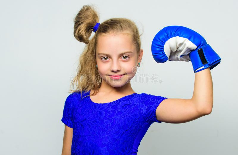 She feels as winner. Upbringing for leadership and winner. Feminist movement. Strong child proud winner boxing. Competition. Girl child happy winner with boxing royalty free stock photo