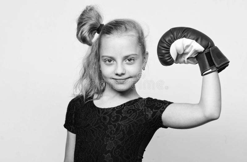 She feels as winner. Upbringing for leadership and winner. Feminist movement. Strong child proud winner boxing. Competition. Girl child happy winner with boxing royalty free stock image