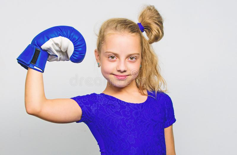 She feels as winner. Upbringing for leadership and winner. Feminist movement. Strong child proud winner boxing. Competition. Girl child happy winner with boxing stock image