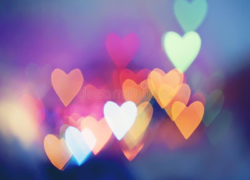 Feestelijke achtergrond met gevormd hart bokeh stock foto's