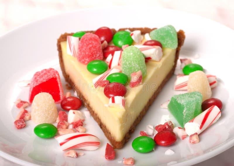Feestelijke Kerstmiskaastaart met geassorteerd suikergoed stock foto