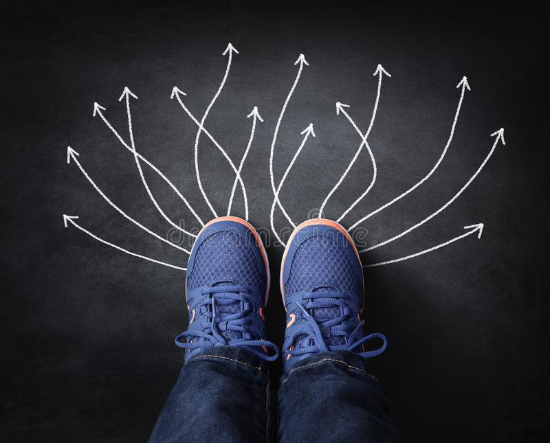 Feet with arrows taking decisions for the future stock photo