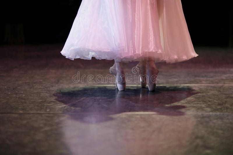 The feet of ballerinas on the stage. Of the theater during the performance of a part in a ballet performance royalty free stock images