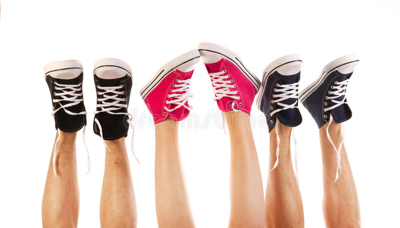 Feet in basketball shoes. Isolated over white background royalty free stock images