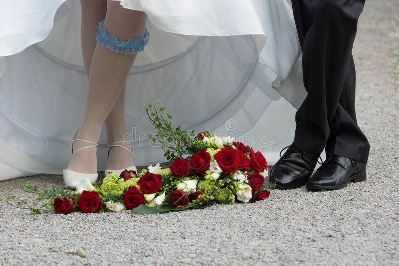 Feet of bride and bridegroom royalty free stock images