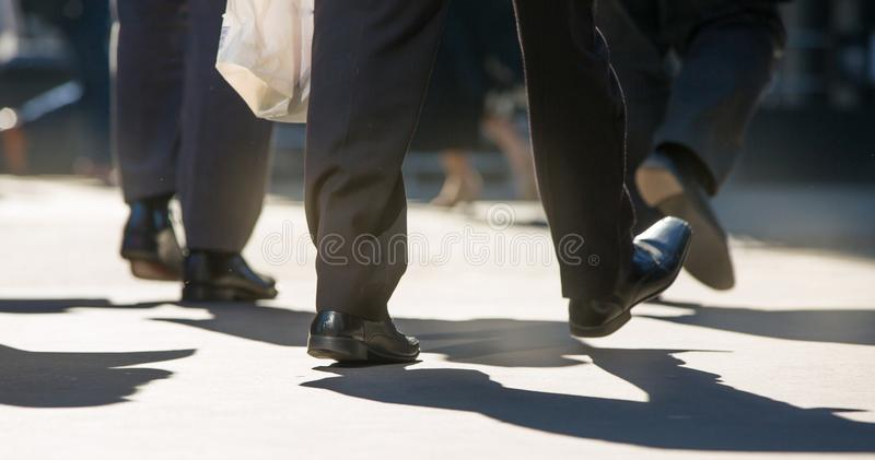 Feet of business people walking in the City of London. Busy modern life concept. London, UK - March 15, 2017: Feet of business people walking in the City of royalty free stock photo