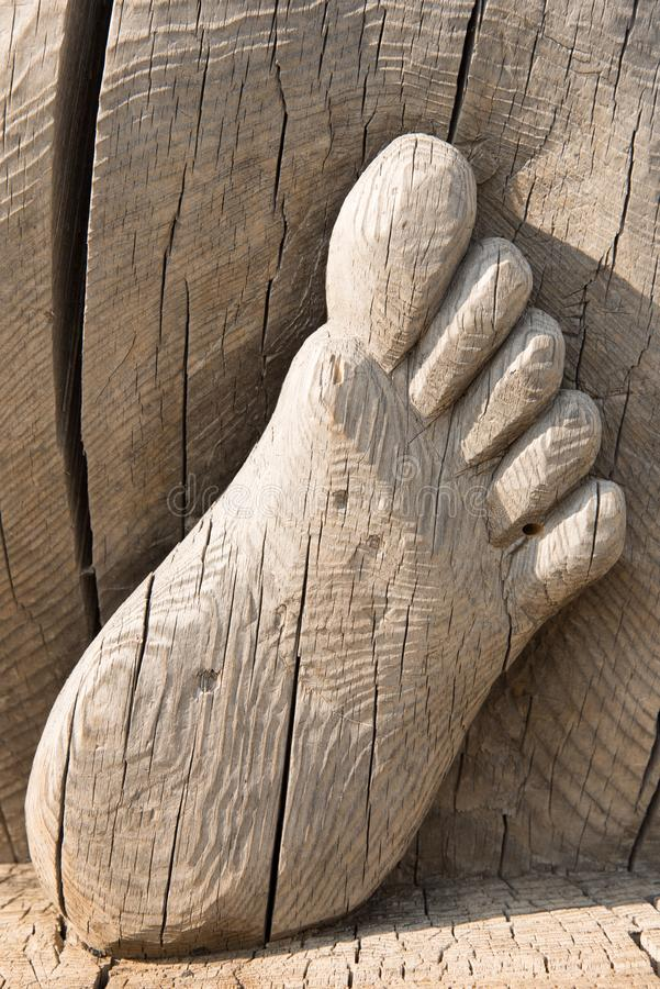 Close - up of feet carved from wood royalty free stock photo