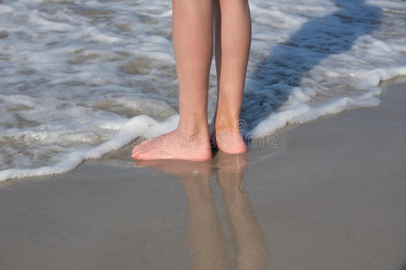 A child`s feet at the beach stock image