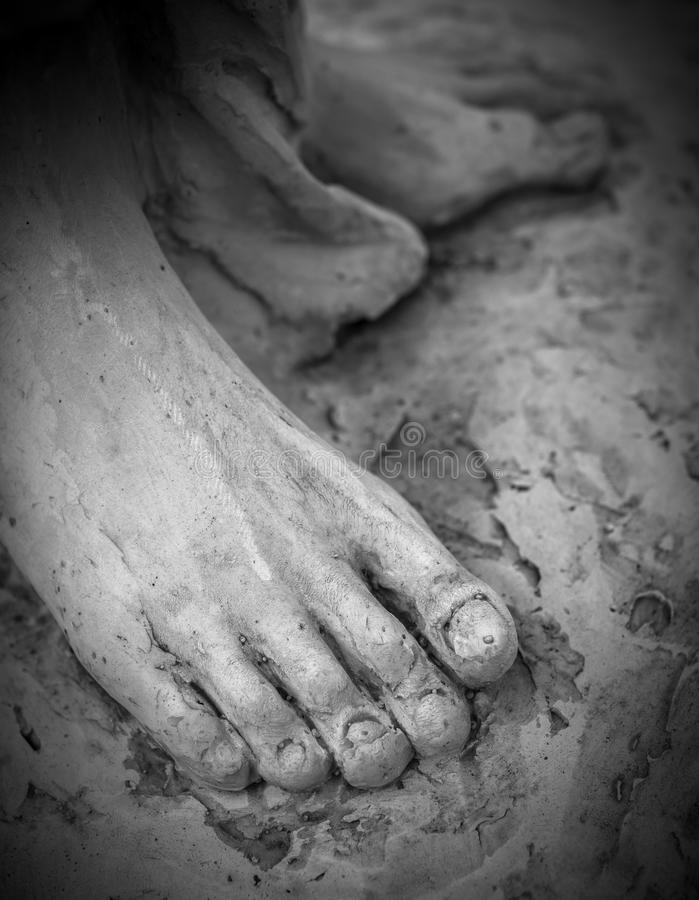 The feet of Christ. Detail of a marble statue, depicting the foot of the suffering Christ royalty free stock photo