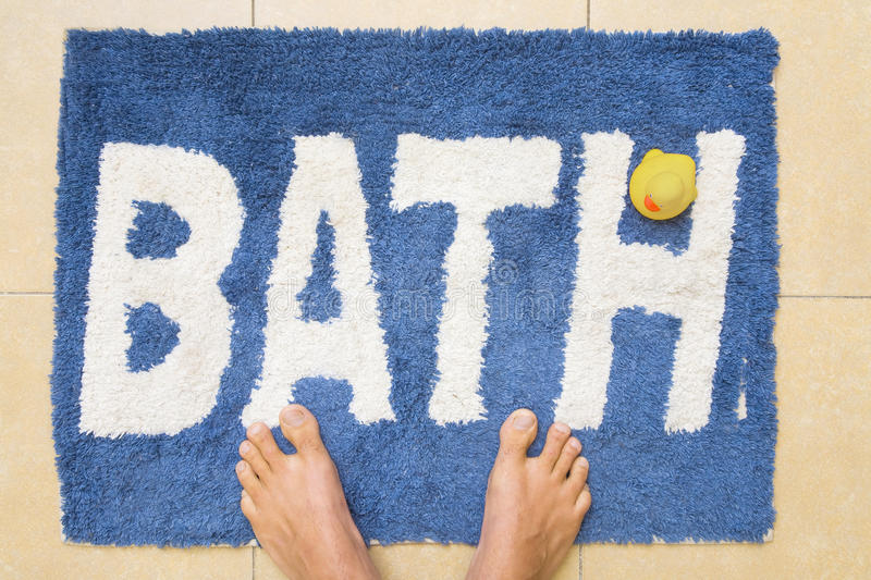 Feet And Duckie on Bathmat royalty free stock image