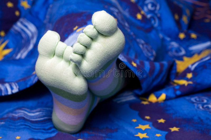 Download Feet In Funny Striped Socks Stock Photo - Image: 8165938