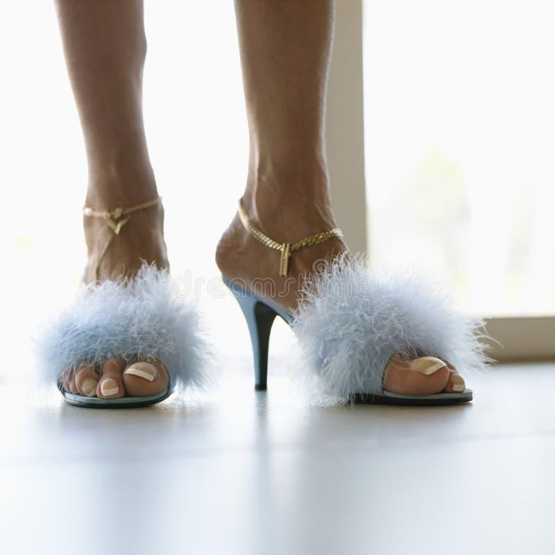Feet in furry heels. stock images