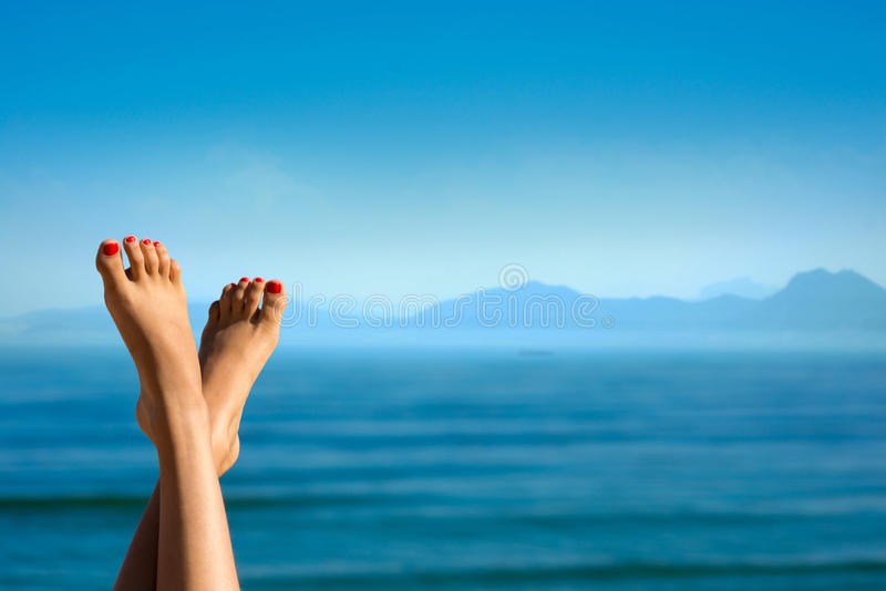 Feet of girl on the background of mountains. stock photography