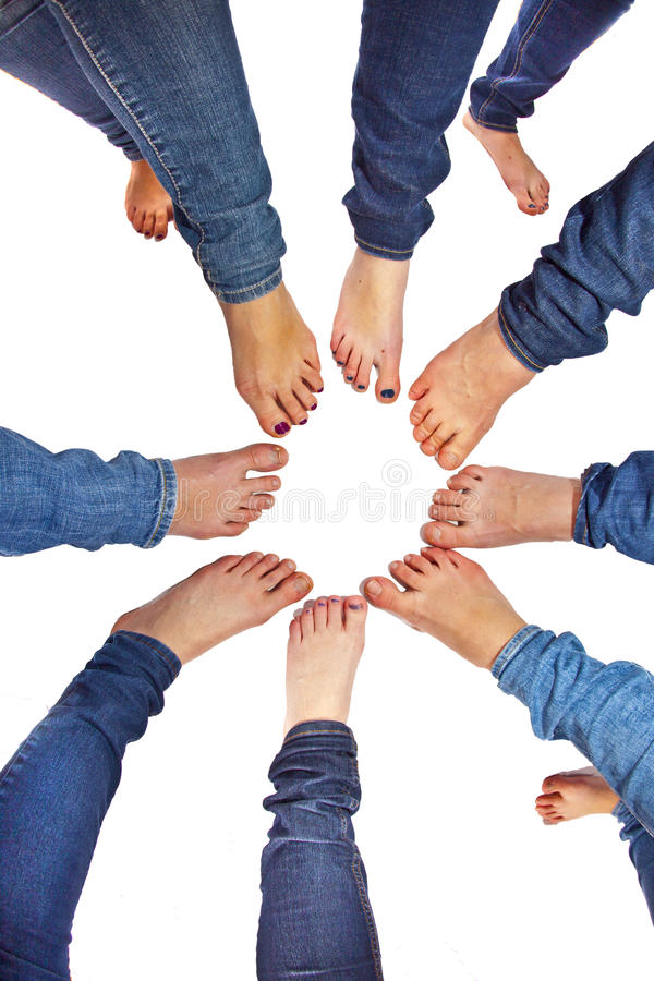 Feet of girls with jeans in a circle royalty free stock image