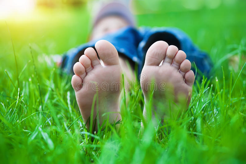 Feet on grass. Family picnic in spring park. Children's feet on grass. Family picnic in spring park stock photo