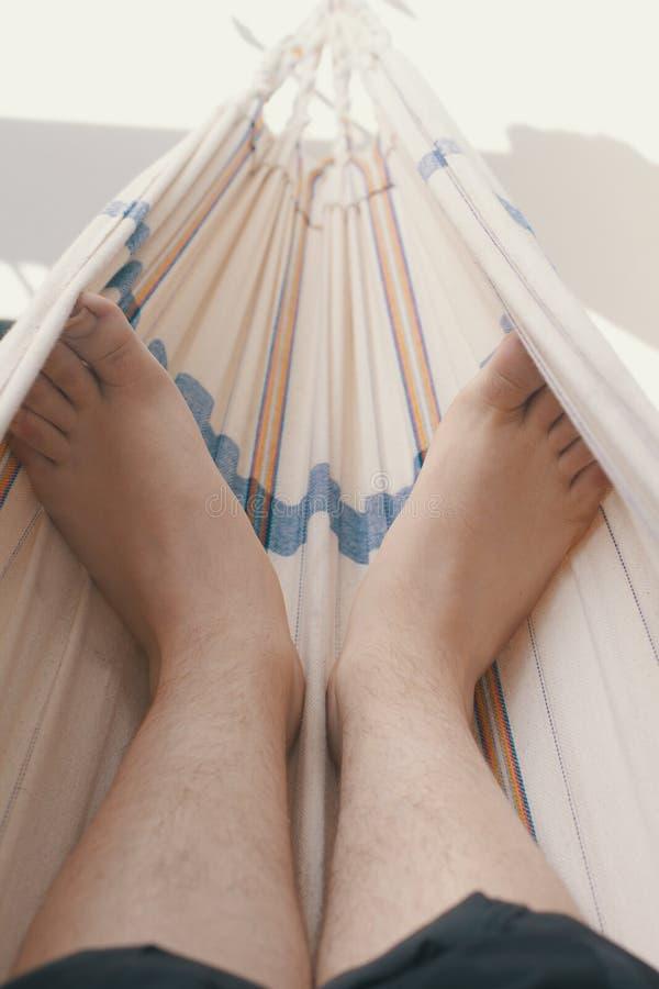 Feet in hammock royalty free stock image
