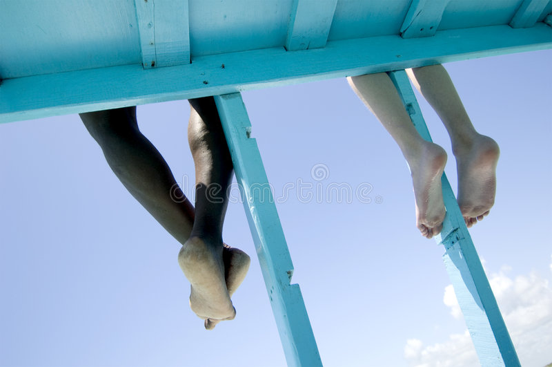 Feet hanging stock photography