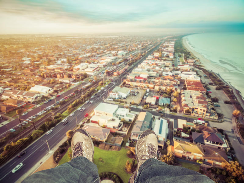 Feet hanging out of helicopter above Patterson Lakes suburb and. Nepean Highway at sunrise. Melbourne, Victoria, Australia stock image
