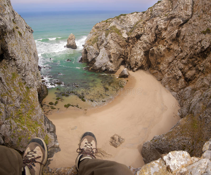 Download Feet Hanging Over Beach Cliff Stock Photos - Image: 21977933
