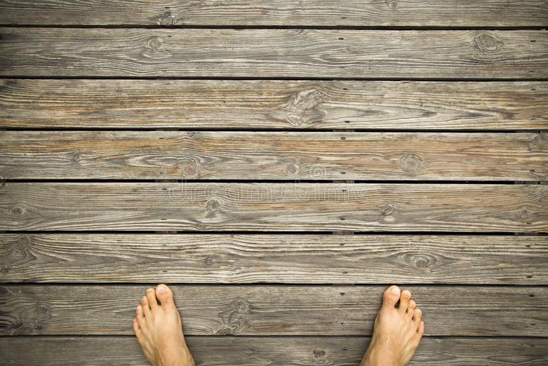 Download Feet on a hardwood floor stock photo. Image of cracked - 27194154