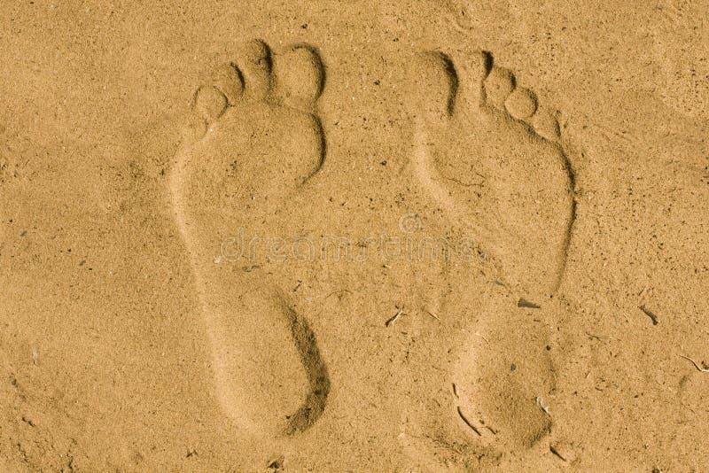 Feet imprint in sand stock photos