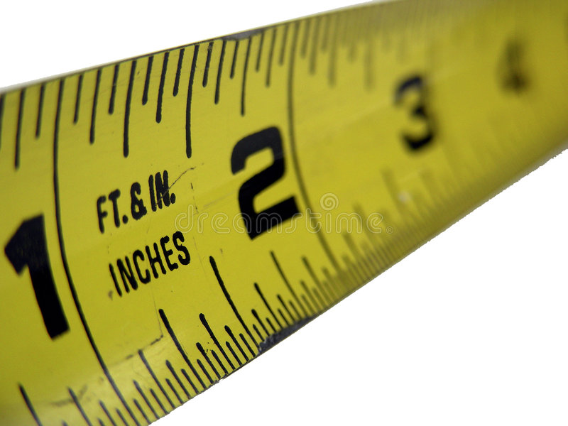 Feet and Inches. Beginning inches of a tape measure stock images