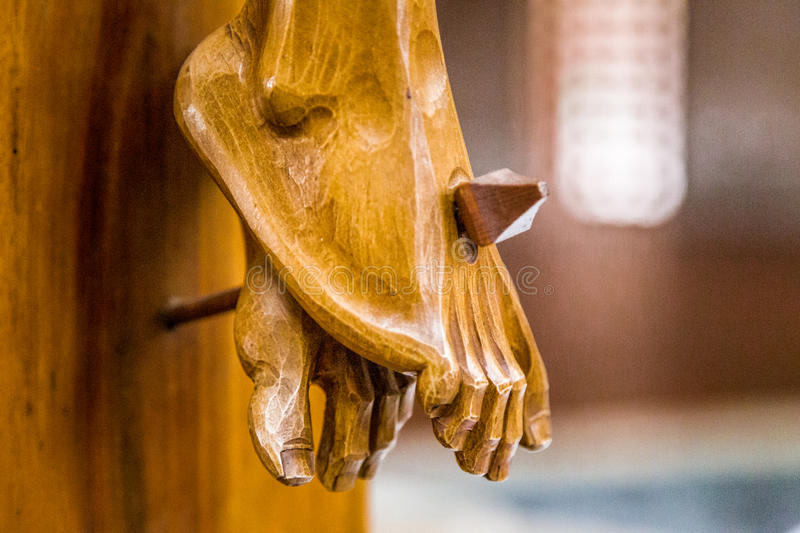 The feet of Jesus Christ nailed to the Holy Cross royalty free stock image