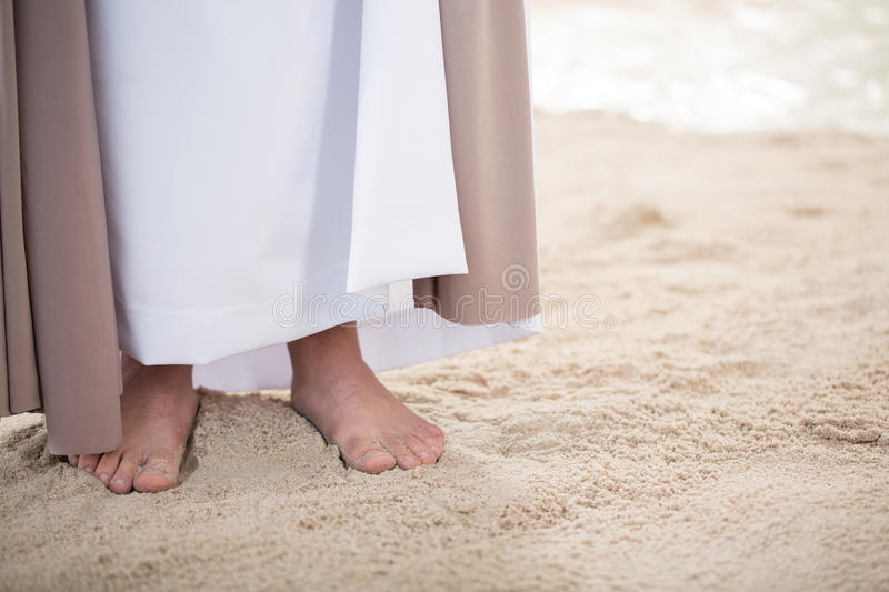 Feet of Jesus on sand royalty free stock photography