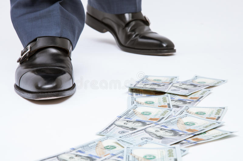 Feet of man in black shoes standing near the money track. Closeup shot stock images