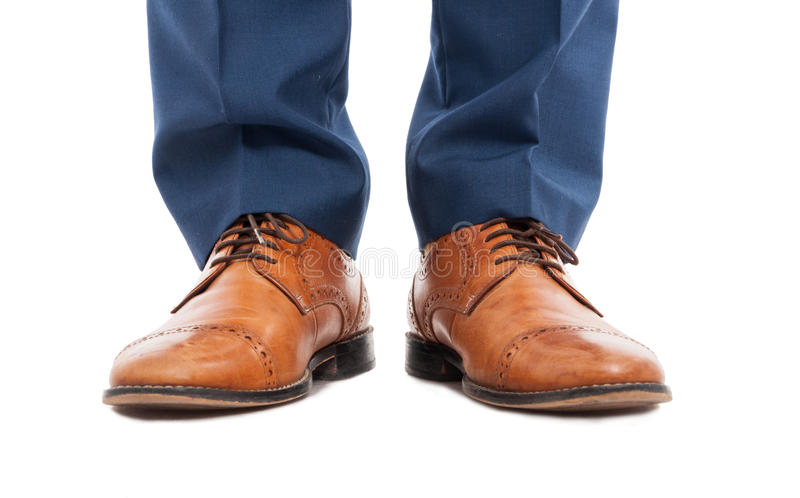 Feet of man with brown shoes in close-up stock photos