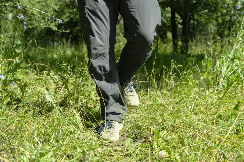 Feet of a man running in nature for background stock image