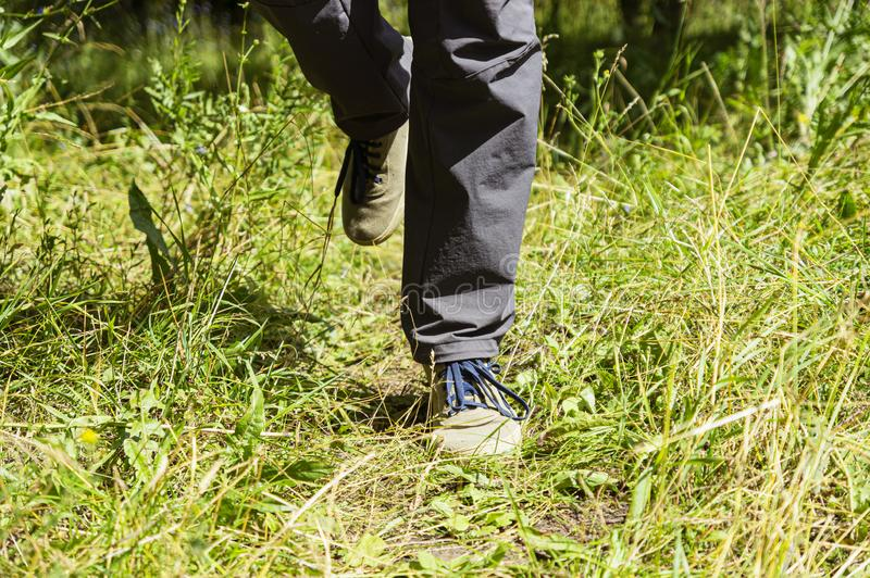 Feet of a man running in nature for background stock photography