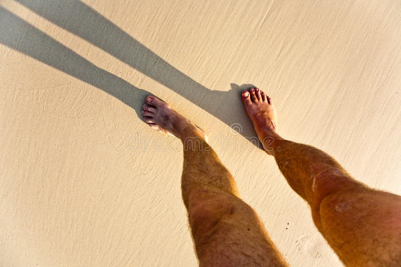 Download Feet Of Man With Shadow At The Beach Stock Photo - Image of island, together: 15541346