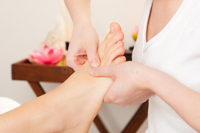 Feet Massage in spa stock images