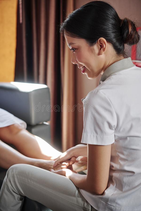 Feet massage in spa salon royalty free stock photography