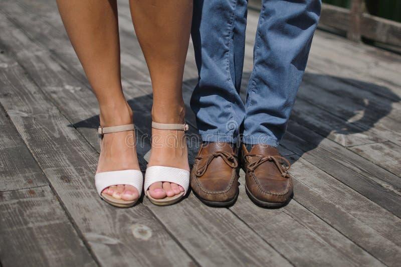 Feet of men and women stock photos