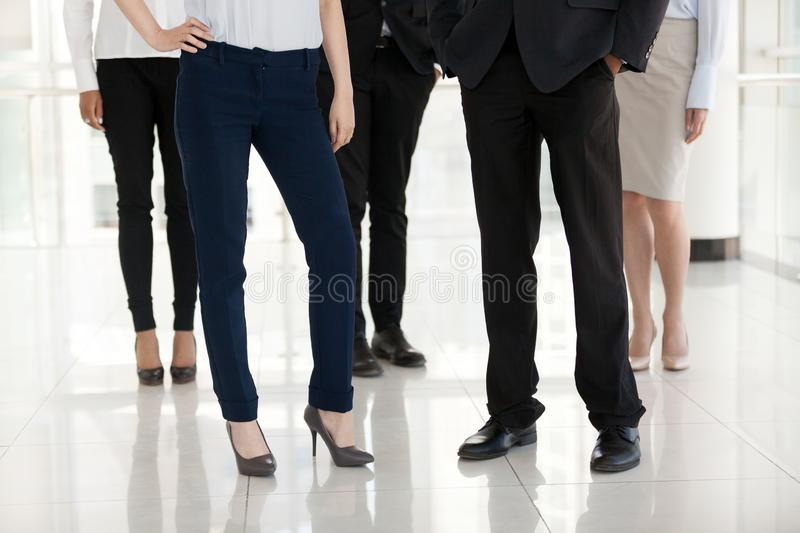 Feet of millennial businessman and businessmen posing indoors royalty free stock image