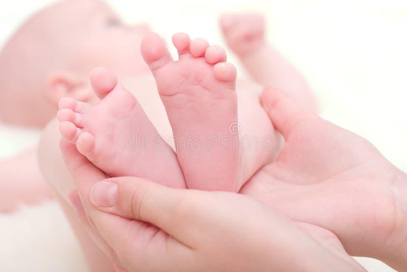 Feet of newborn baby stock photo