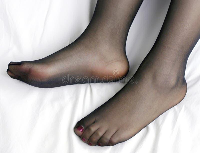 Feet and nylon royalty free stock photography