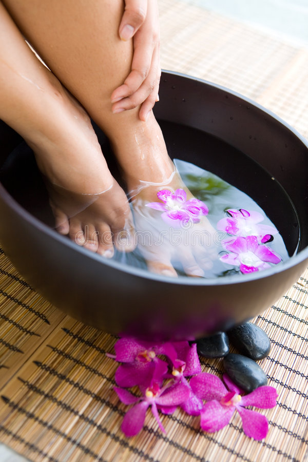 Download Feet In Oriental Foot Bath With Flowers Royalty Free Stock Photography - Image: 8608687