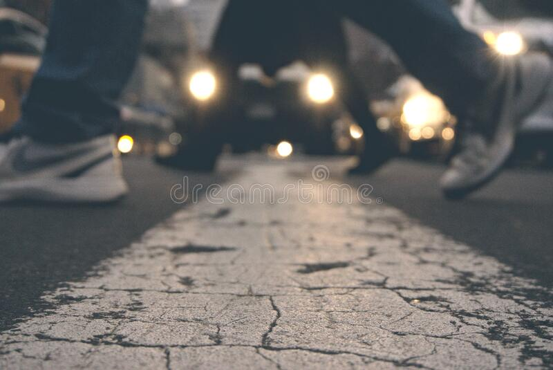 Feet of pedestrians crossing road royalty free stock image