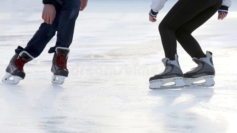 The feet of the people skating at the rink. Hobbies and recreation. Sports and holidays royalty free stock photo