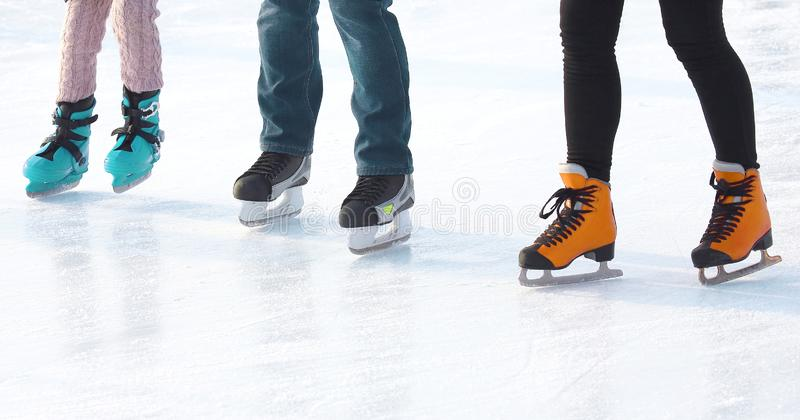 Feet of people skating on a street ice rink. sports, Hobbies and recreation of active people. The Feet of people skating on a street ice rink. sports, Hobbies royalty free stock photo
