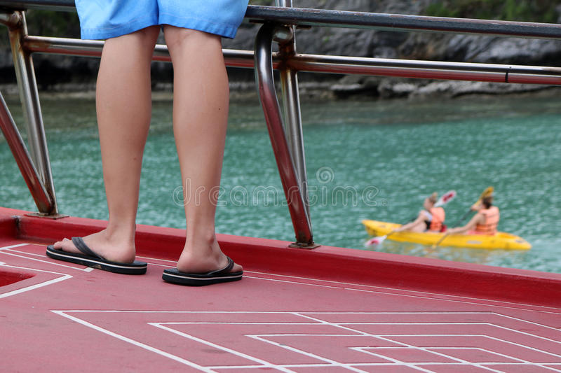 Feet of the people on the tour boat and kayak activities background. stock photography