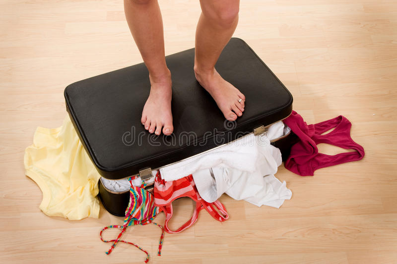 Download Feet of person on suitcase stock image. Image of vacationing - 13125279