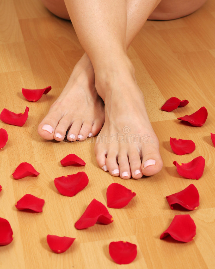 Feet and petals stock photography
