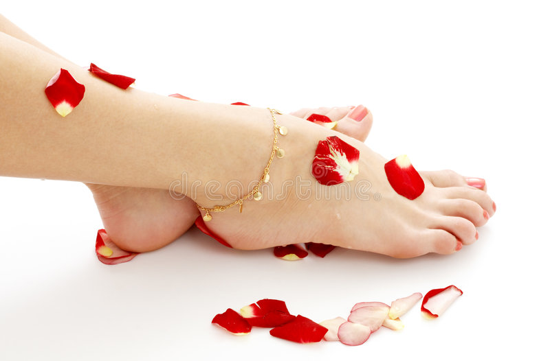 Feet with petals in spa stock photo