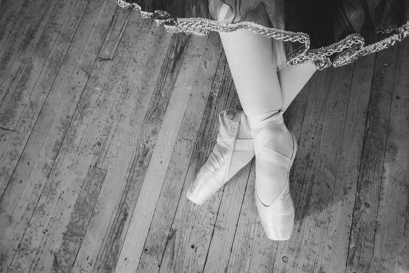 Feet in Pointe shoes on the floor royalty free stock image