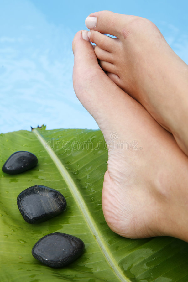 Feet By Pool Stock Photo