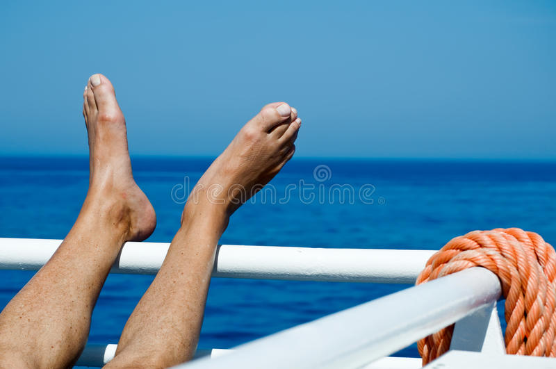 Download Feet on the Railing stock photo. Image of clear, summer - 11244778